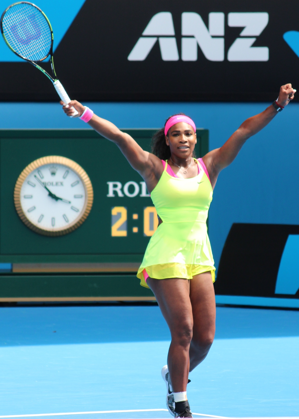 Serena Williams, the greatest athlete of all time, with both arms raised in victory