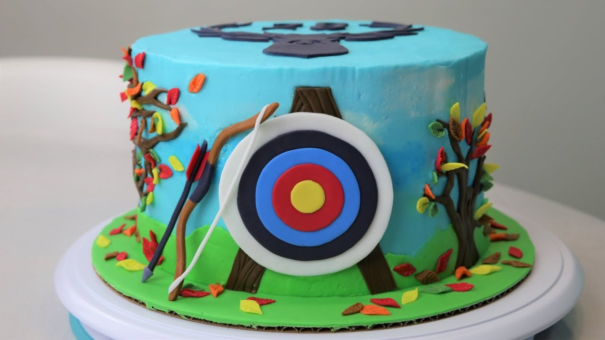 A cake with a decoration of an archery target
