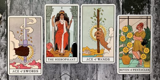 A spread of four tarot cards - the Ace of Swords, the Hierophant, Ace of Wands, and Seven of Pentacles - spread out against a wooden background