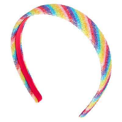 an alice band in gaudy rainbow colours