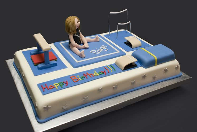a cake decorated to look like gymnastics equipment