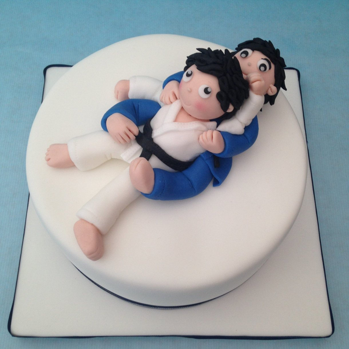 a cake of two judokas humping on their backs