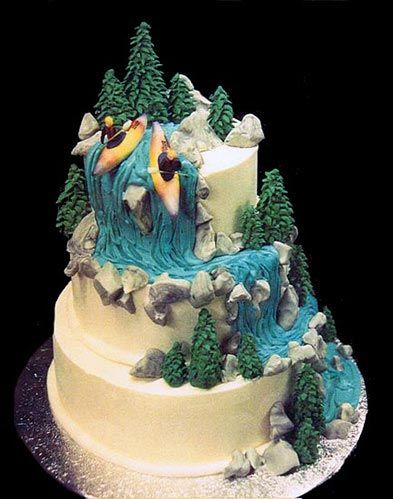 an incredible cake with a decoration of two kayakers paddling down a waterfall