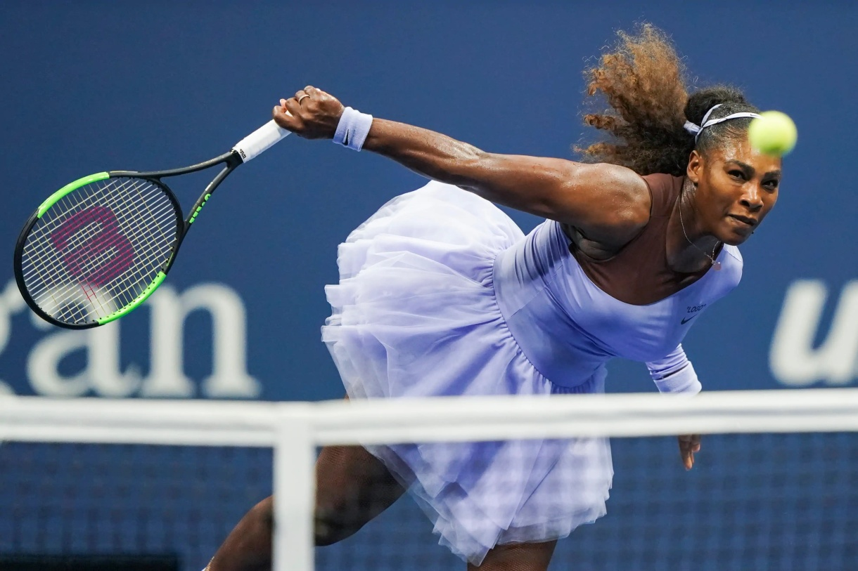 Serena Williams, the greatest athlete of all time, hitting a serve