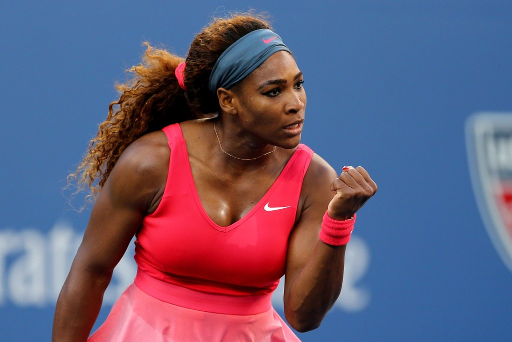 Serena Williams, the greatest athlete of all time, pumping her fist with a look of determination on her face