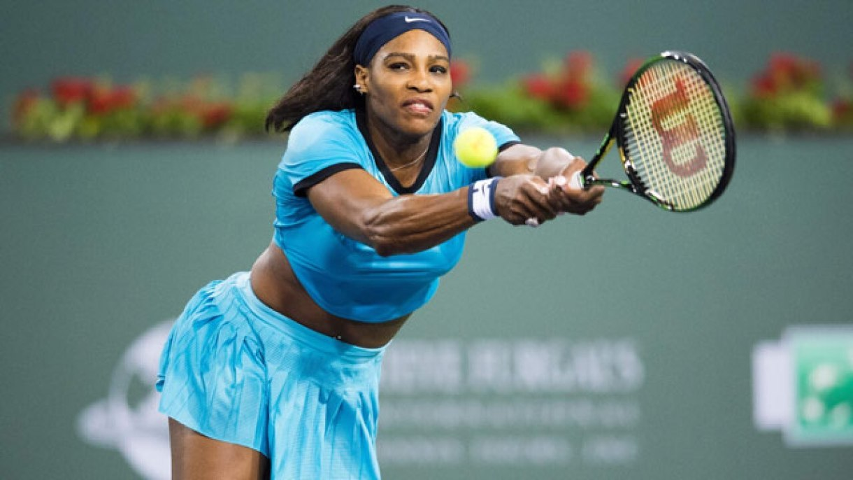 Serena Williams, the greatest athlete of all time, reaching to make a return shot