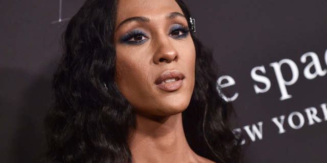 A close-up photo of MJ Rodriguez beautifully made up and dressed for a red carpet event