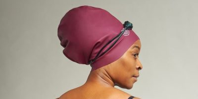 a Black woman wearing a soul cap swimming cap over her hair