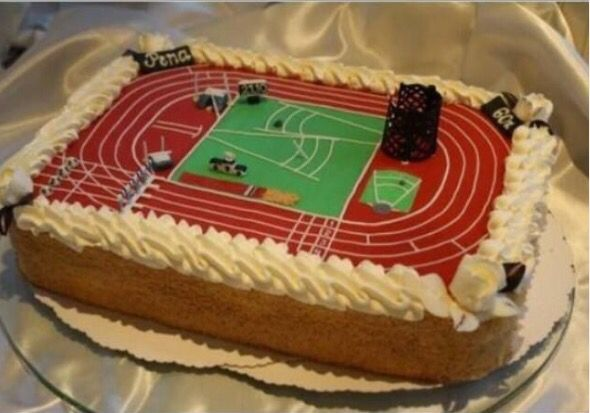 a cake decorated to look like an athletics track