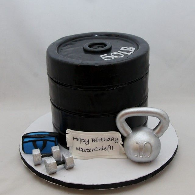 a cake decorated to look like various sorts of weights