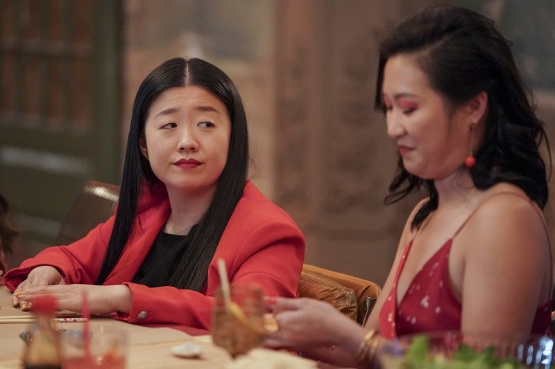 Alice and Sumi try their hand at making dumplings during the Coterie's Lunar New Year celebration.