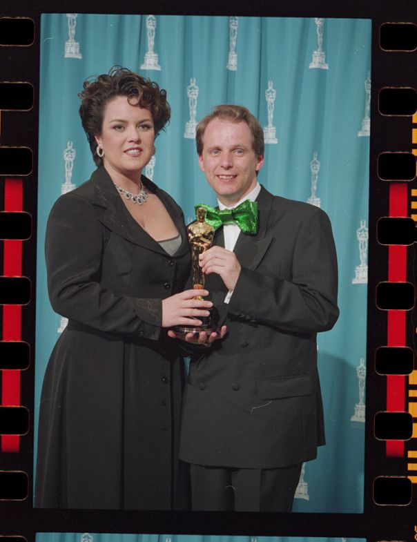 Nick Park Holding His Oscar with Presenter Rosie O'Donnell