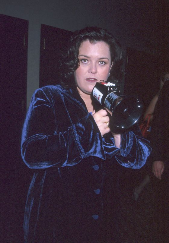 Rosie in a velvet blazer and a loudspeaker
