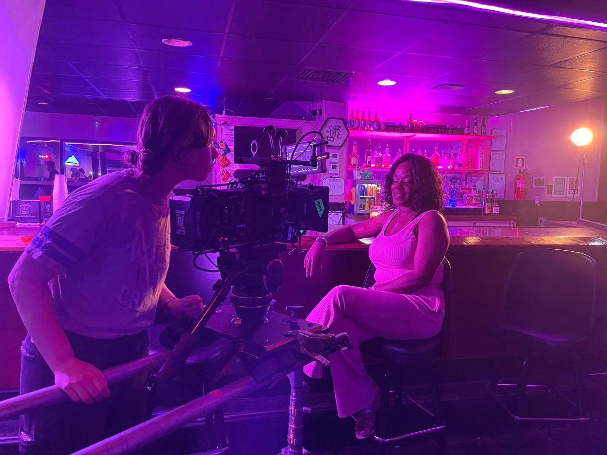 Rachel Smallman, owner of Herz lesbian bar, is filmed for The Lesbian Bar Project