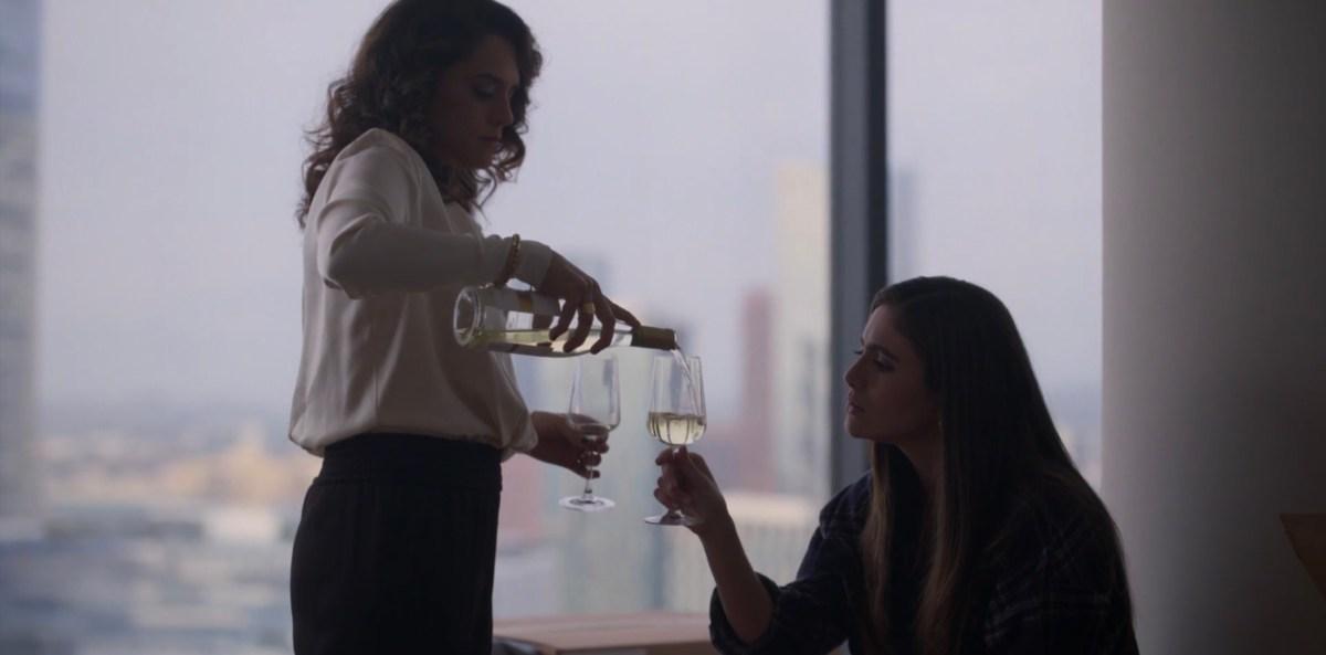 Gigi pours wine for Dani