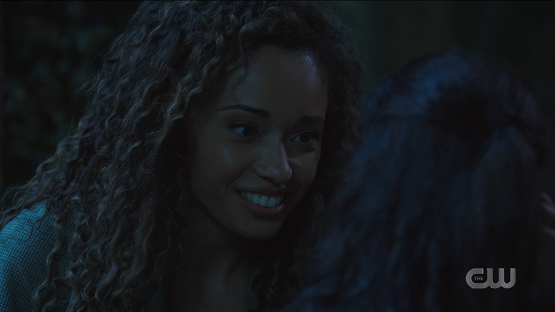 Astra smiles softly and lovingly at little Esperanza