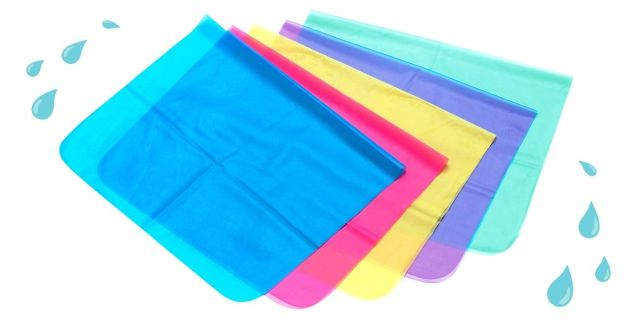 Five dental dams in different colors (blue, red, yellow, purple, and green) are against a white background. Water droplets appear in the upper left and lower right corners of the image.