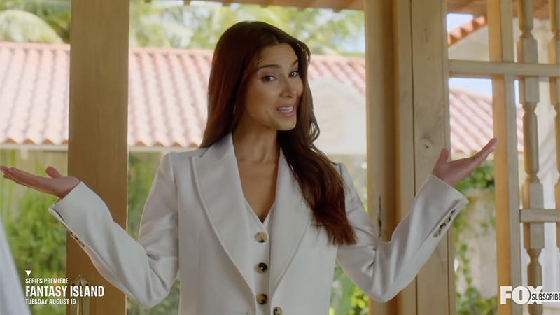 Elena holds out her hands in welcome to Fantasy Island