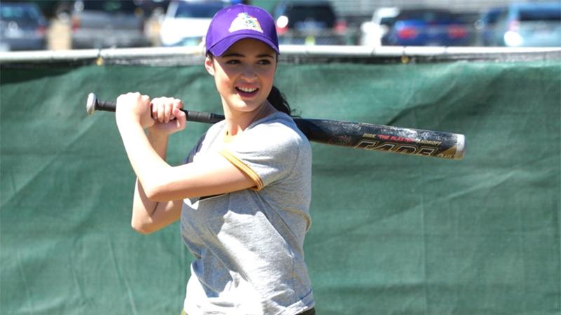 Nicole holds a softball bat
