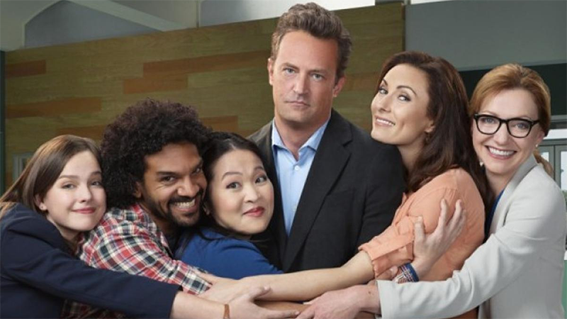 The cast of Go On in a group hug