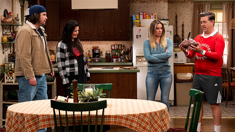 Allison and Patty stand in the kitchen with Kevin