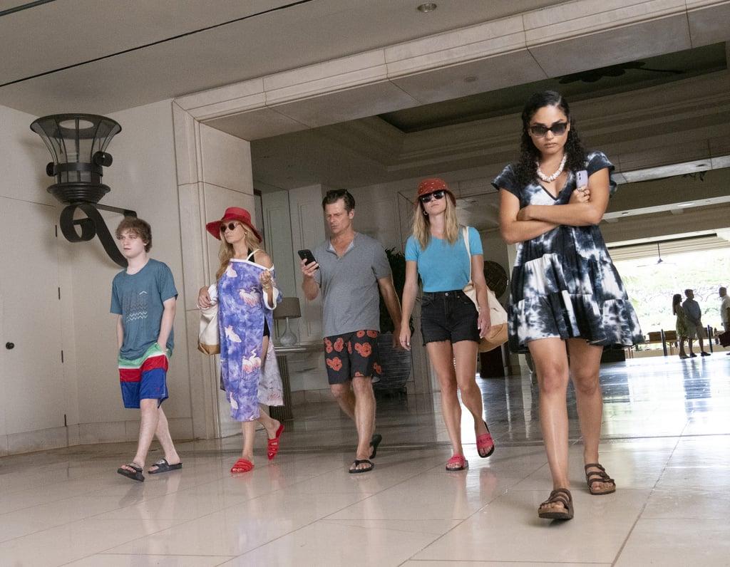 Paula walks away from Olivia and her terrible family in the hotel lobby