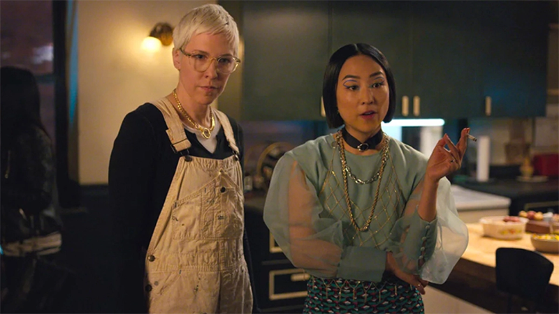 Lizzy and Maxine stand in the kitchen in Russian Doll