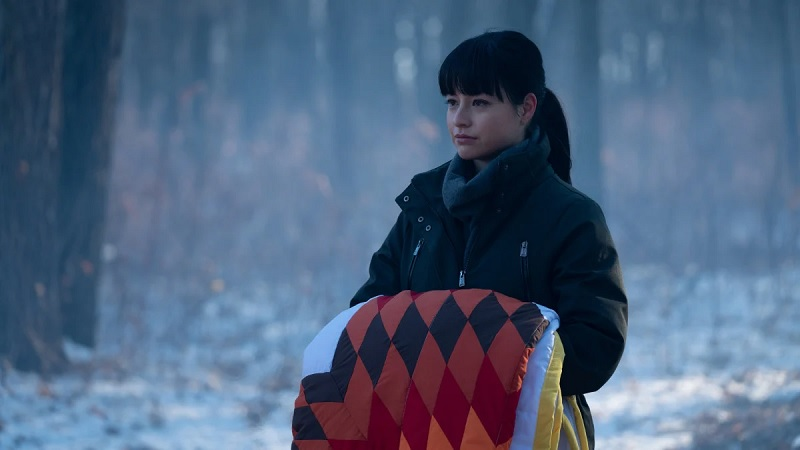 Luna holds a quilt as she participates in her naming ceremony, on the series finale of Burden of Truth.