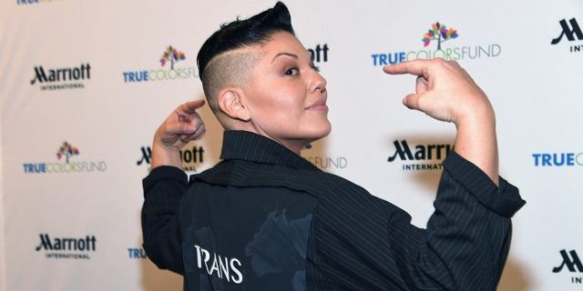 """Sara Ramirez Lex profile went u today, here they are on the red carpet in a black coat that says """"Trans Is Beautiful"""""""