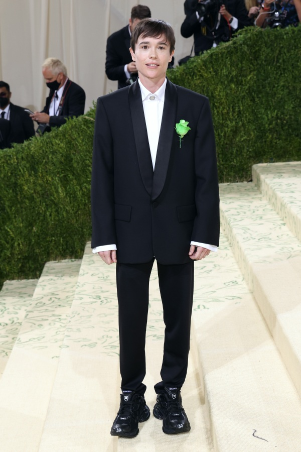 Elliott Page in a black tux and a green ribbon on his lapel