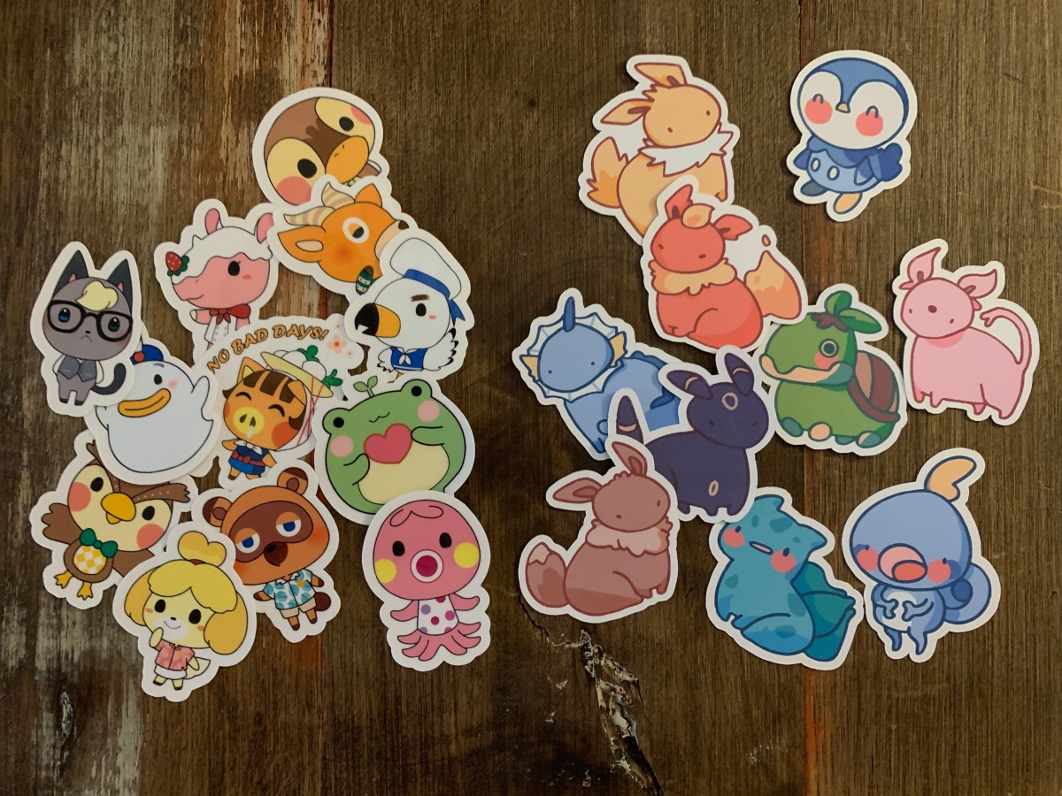 A selection of Pokemon and Animal Crossing stickers in pastel colors