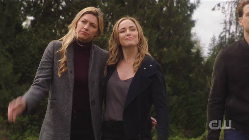 Sara and Ava walk together, each with an arm around her wife
