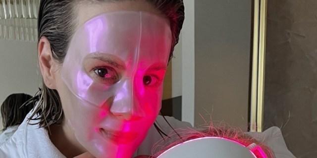 Sarah Paulson is wearing a hot pink laser mask