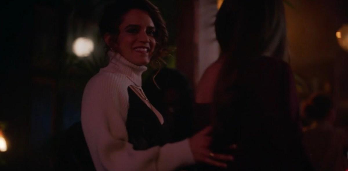Gigi guiding Dani to the bar