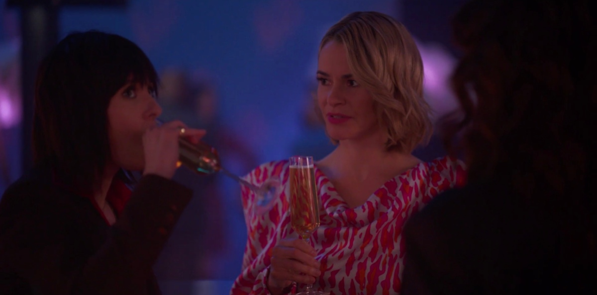 Alice and Shane drinking champagne