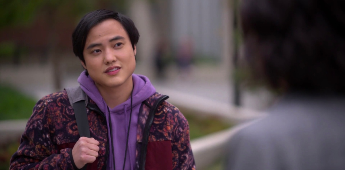 Micah in a purple hoodie outside the LGBT Center