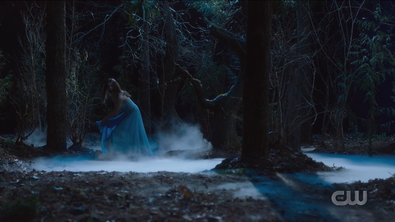 Nia gets her dress caught on a branch in her foggy forest dreamscape