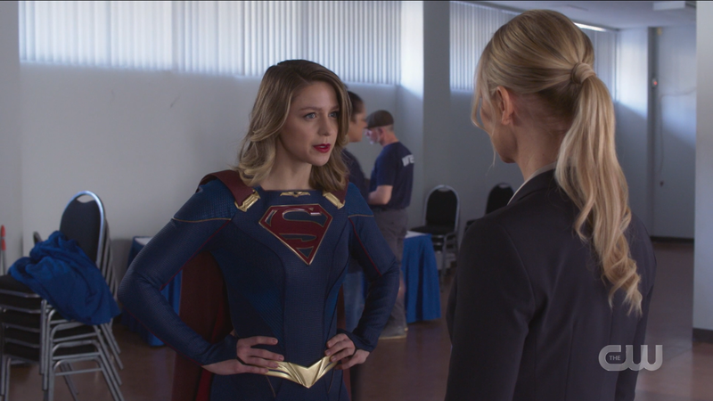 Supergirl stands with her hands on her hips looking like a white woman on twitter