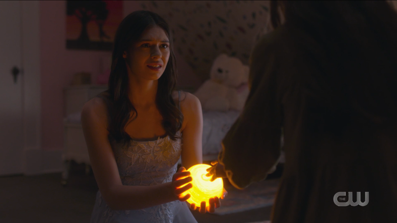 Nia holds out her lil ball of light to Maeve