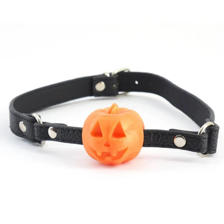 """A black, faux leather ball gag (but the """"ball"""" is a silicone orange jack-o-lantern)"""