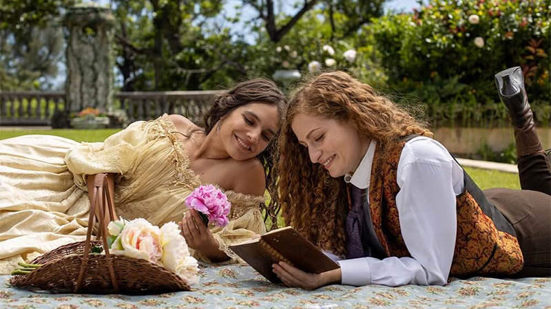 Rachel and Isabel read together on the lawn