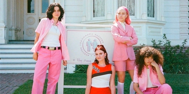 The band MUNA recreates a scene from But I'm a Cheerleader in all pink