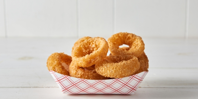 A delicious basket of fried onion rings