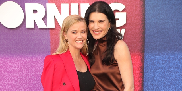 """LOS ANGELES, CALIFORNIA - SEPTEMBER 08: (L-R) Reese Witherspoon and Julianna Margulies attend Apple TV+'s """"The Morning Show"""" Photo Call at Four Seasons Hotel Los Angeles at Beverly Hills on September 08, 2021 in Los Angeles, California. (Photo by Leon Bennett/WireImage)"""