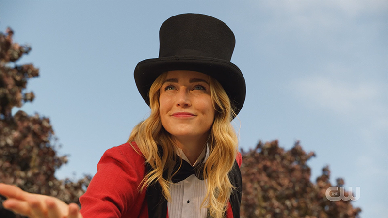 Sara in a top hat being charming