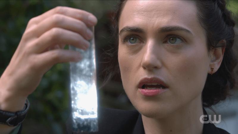Lena looks at her magic vial