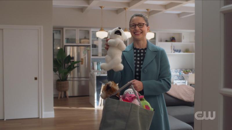 Supergirl recap 615: Kara beams as she holds up a stuffed animal