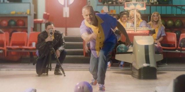 Tracy Kowalski as Alex bowls as Will Krisanda as X films him.