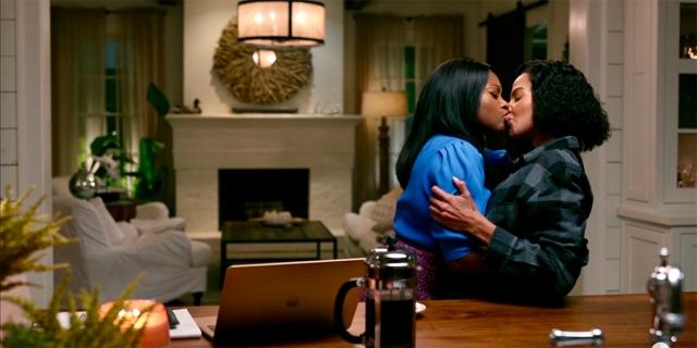 Jill embraces Nina for a big kiss