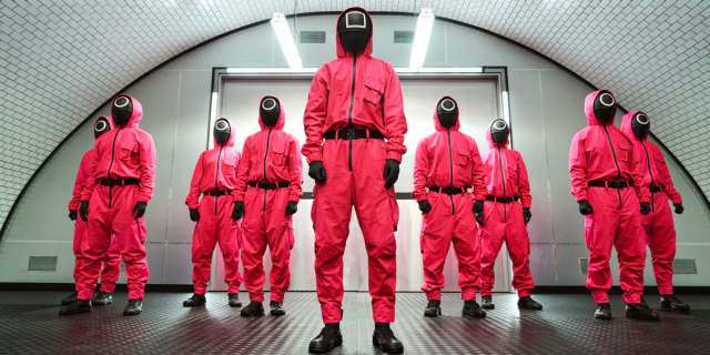 The Squid Game enforcers in red Hazmat suits